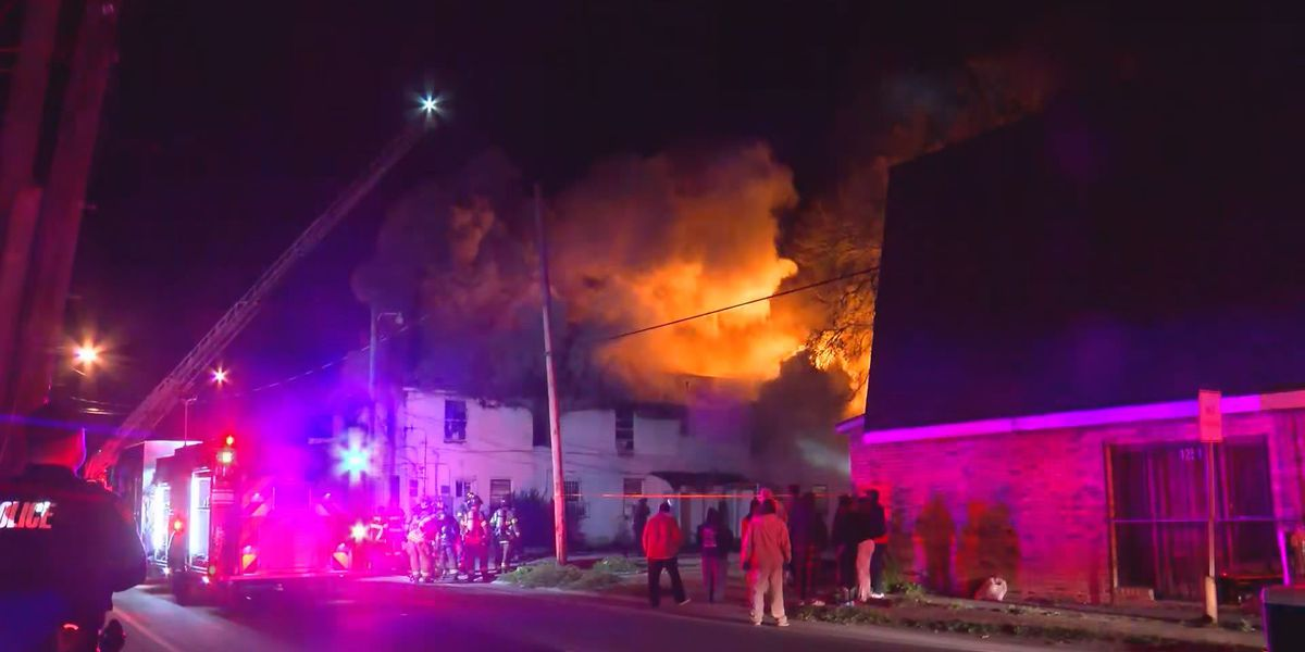 Flames tear through apartment complex on N. Acadian
