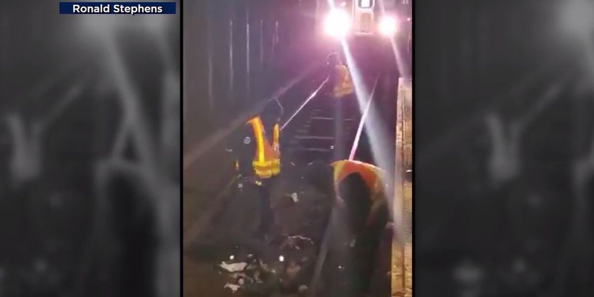 Workers stop subway train with moments to spare after NY man using walker falls onto tracks