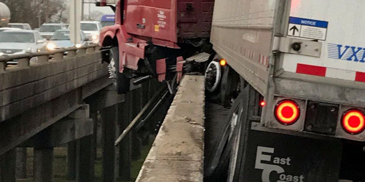 Driver cited in wreck that left 18-wheeler dangling off interstate; huge delays