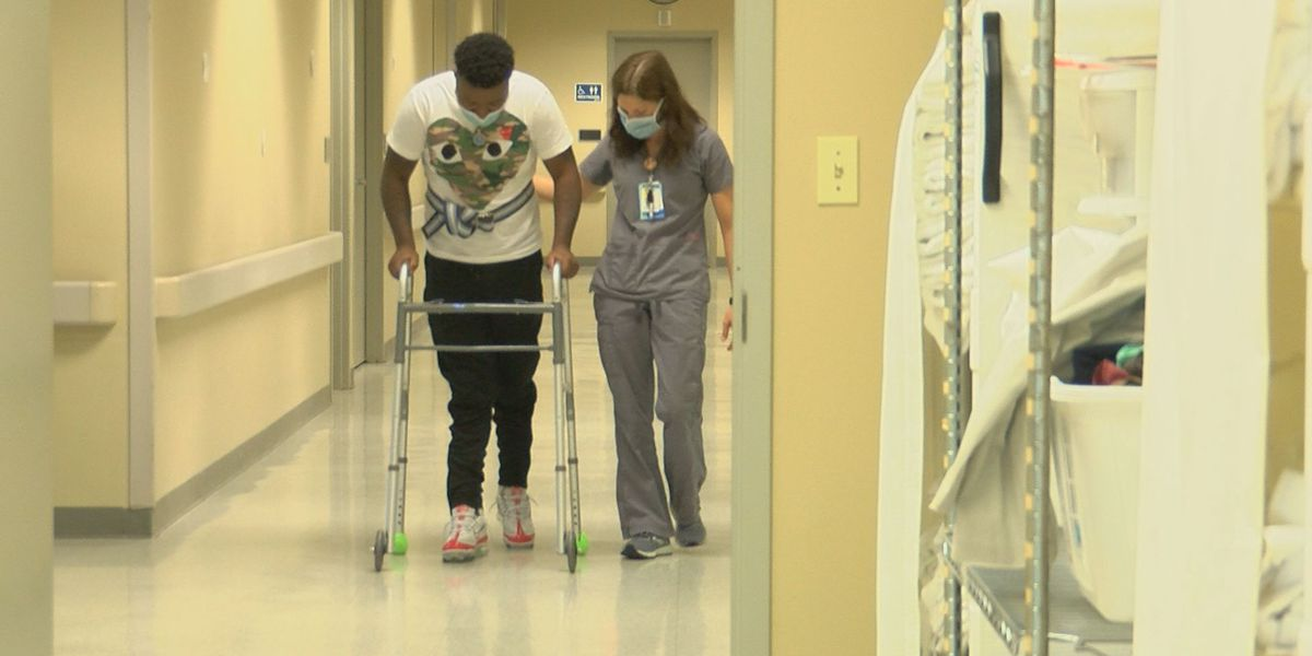 Doctors said he wouldn't be able to move his feet again after he was shot in the spine. A year later, he's walking.
