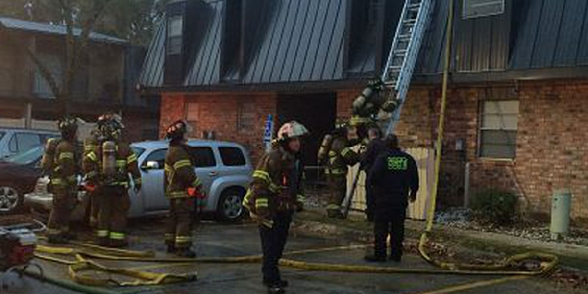 Fire crews work early morning apartment fire