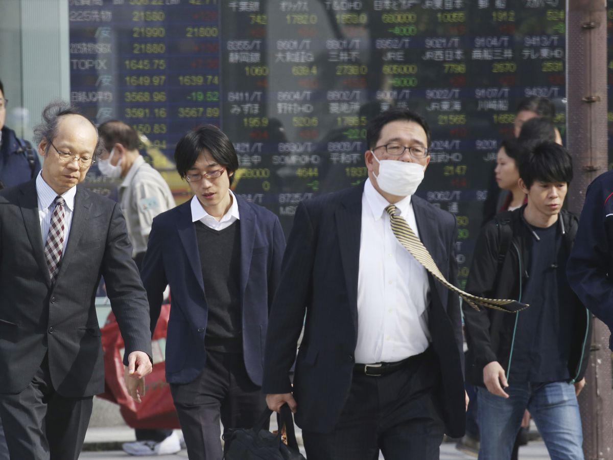 Japan's economy shrank in July-September as trade falls
