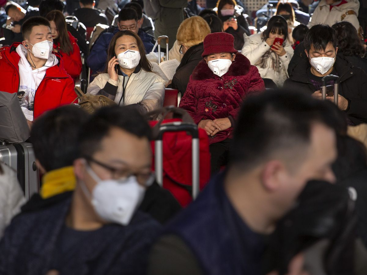 China extends Lunar New Year holiday as new virus toll rises