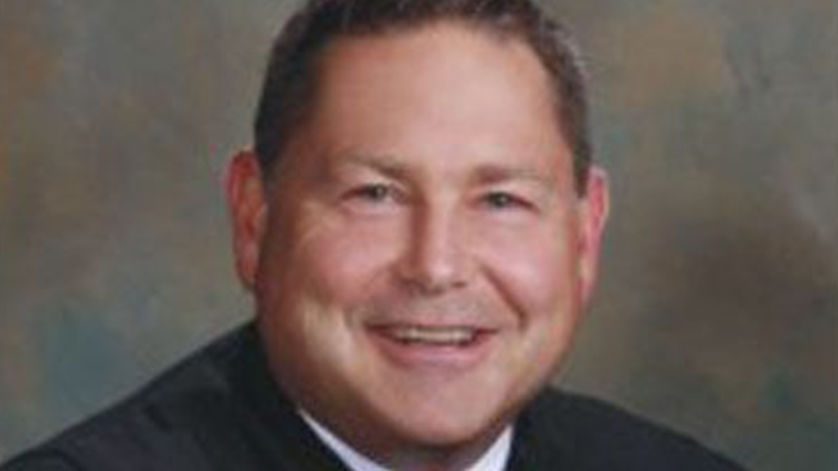 Baton Rouge Judge Chip Moore signs qualifying papers from hospital