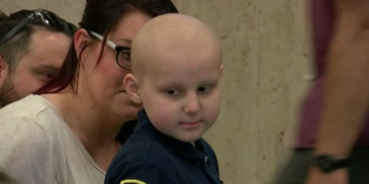 Parma boy battling cancer becomes police officer for a day