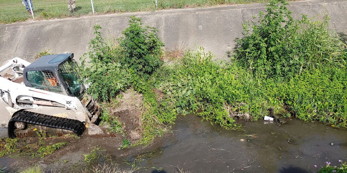 Crews cleaning out drainage canal ahead of expected rainy weekend
