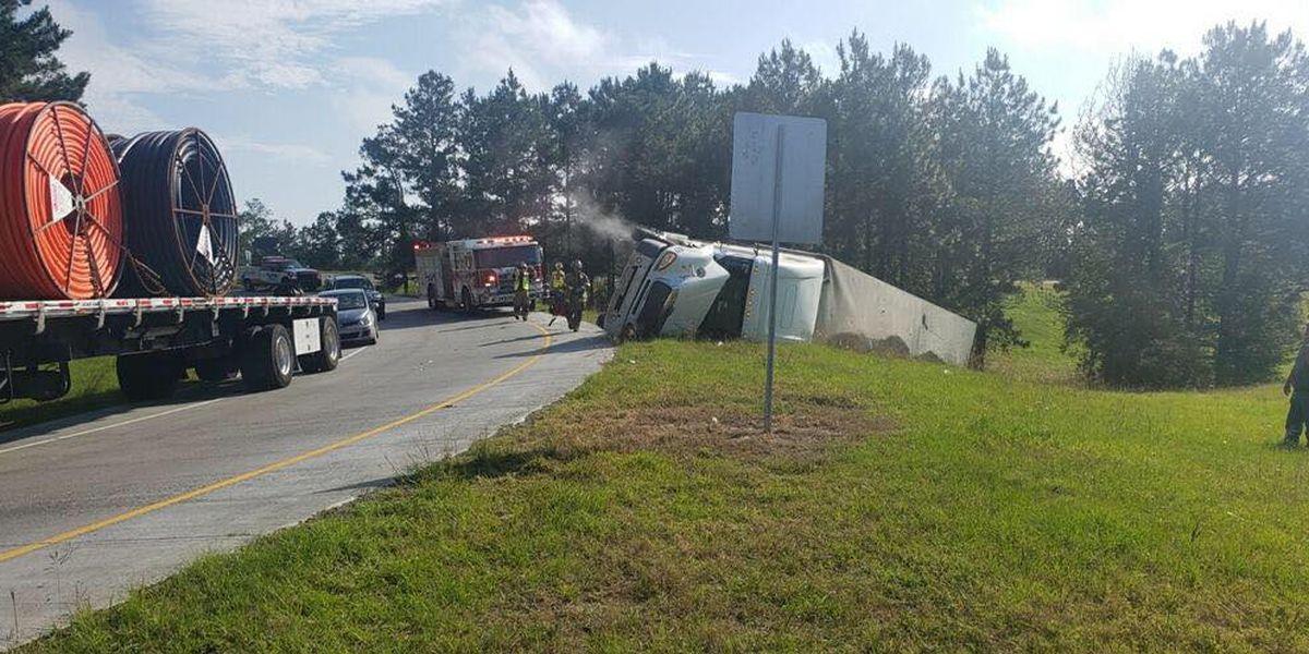 Overturned 18 wheeler at I-12/I-59 interchange