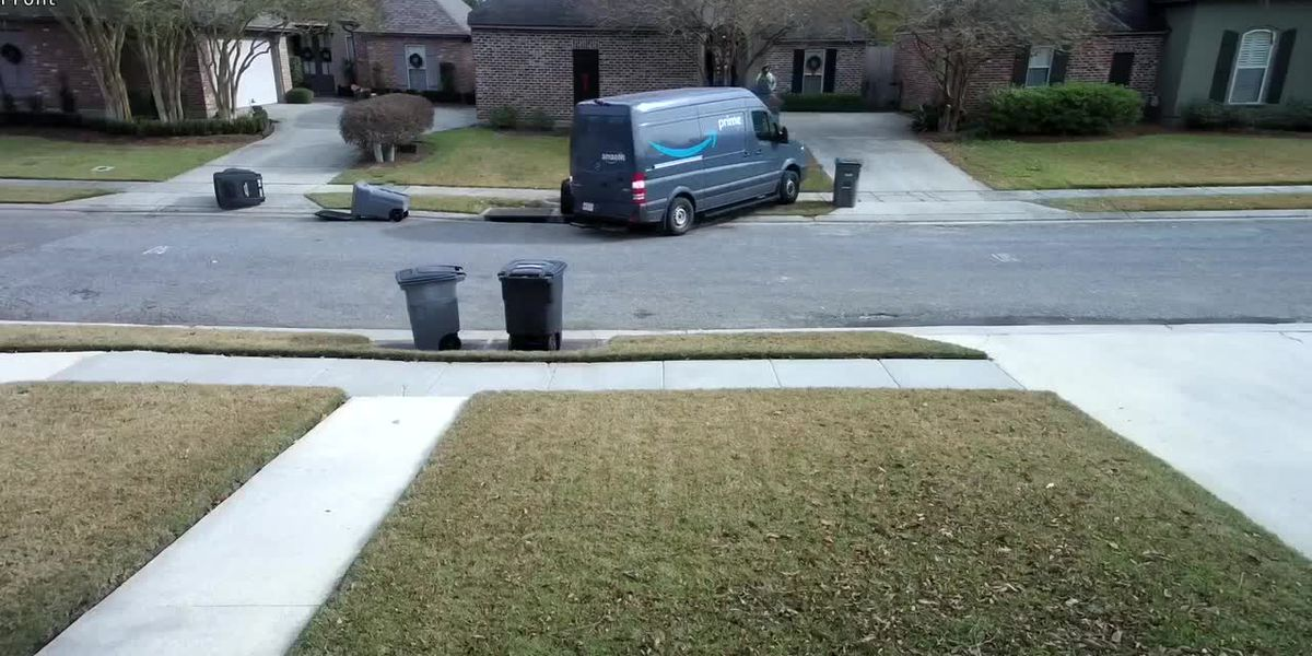WATCH: Amazon delivery van rolls down driveway, hits light pole in Baton Rouge neighborhood