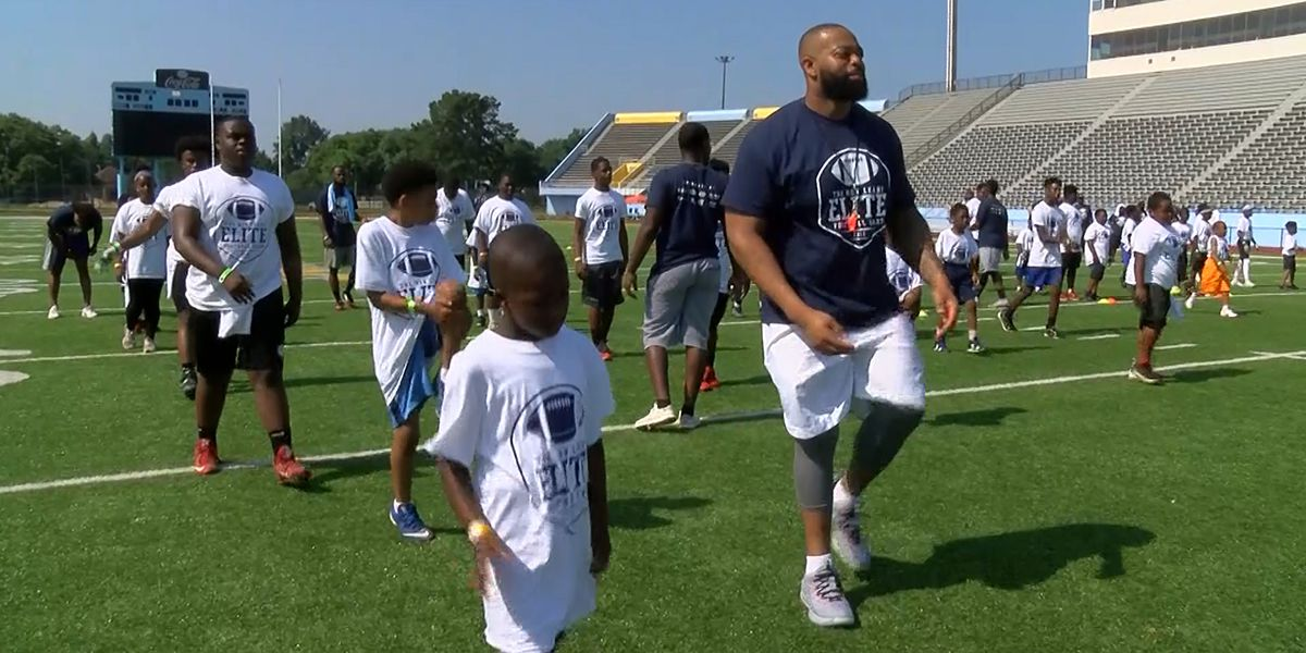 NFL player Ron Leary uses football camp to inspire kids to strive for greatness