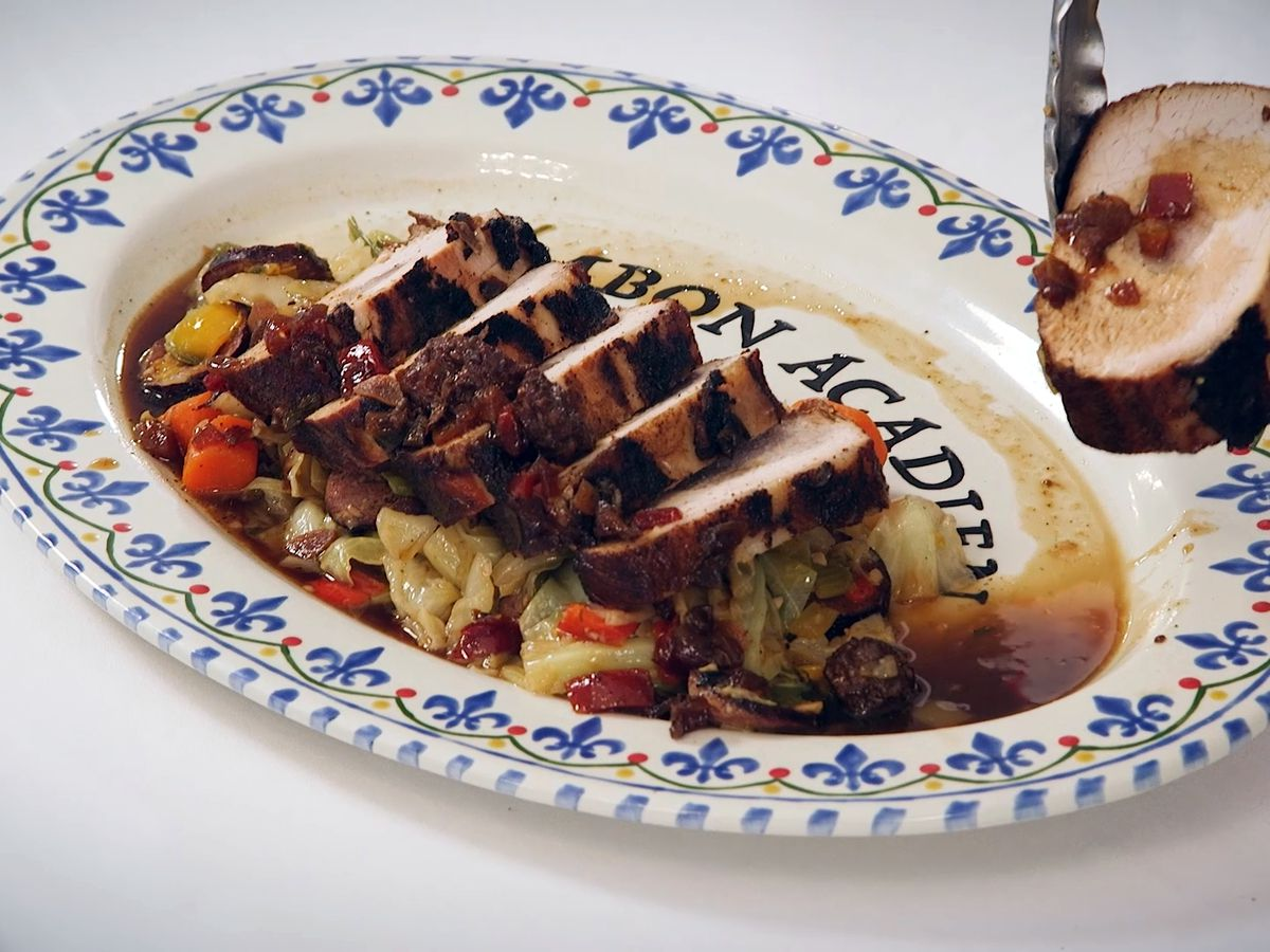 Spicy Brats-Stuffed Pork Loin on Smothered Cabbage