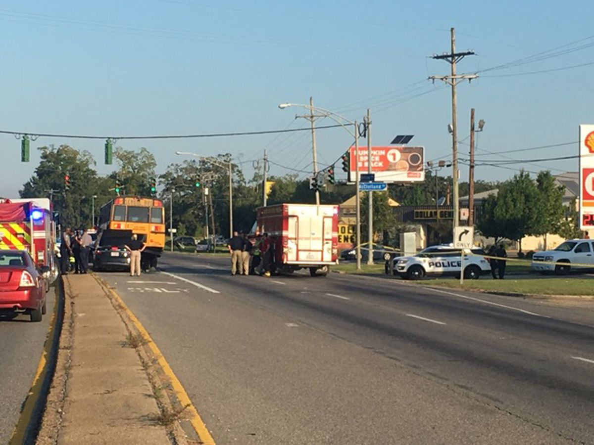Crash involving school bus and car leaves driver dead; baby taken to hospital