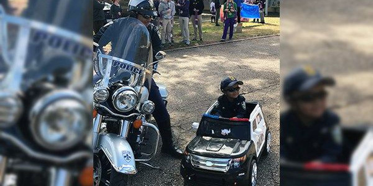 VIDEO: Little boy dresses as cop to ride in school's Mardi Gras parade