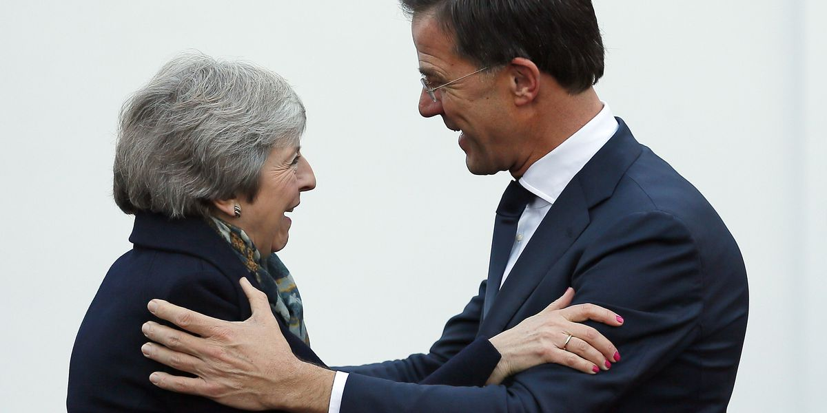 May in the Netherlands as she fights to save Brexit deal