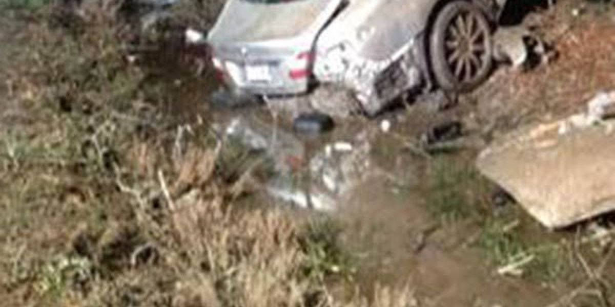 Troopers say driver dies after car flips, hits 2 trees