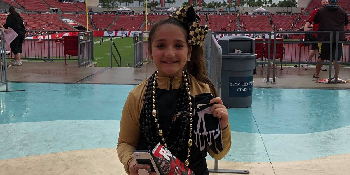 VIDEO: Saints punter Thomas Morstead gives glove to young fan