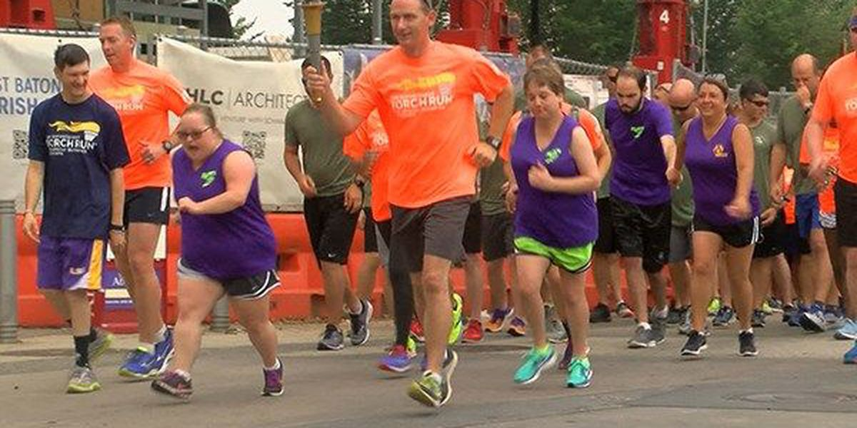 Supporters of Special Olympics carry Flame of Hope through Baton Rouge