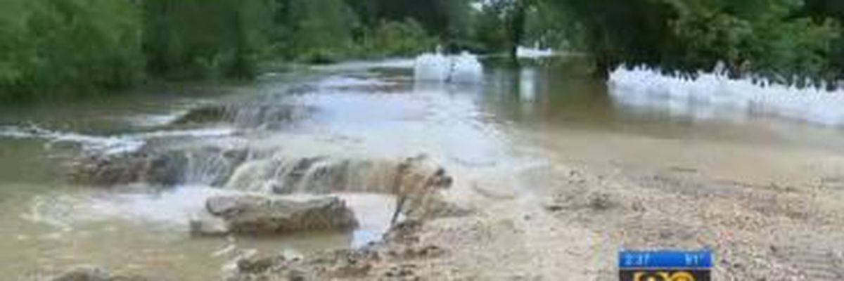 National Guard using sandbags to stop floodwater in Alligator Bayou