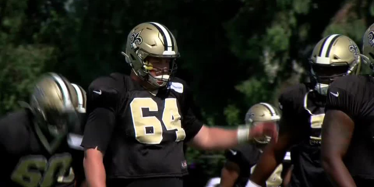 Tommy Clapp checks out his son's exploits in Saints-Chargers dual practice