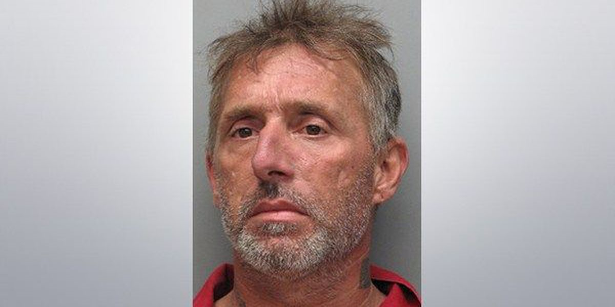 Police find heroin, needles on man asleep in truck at stop sign