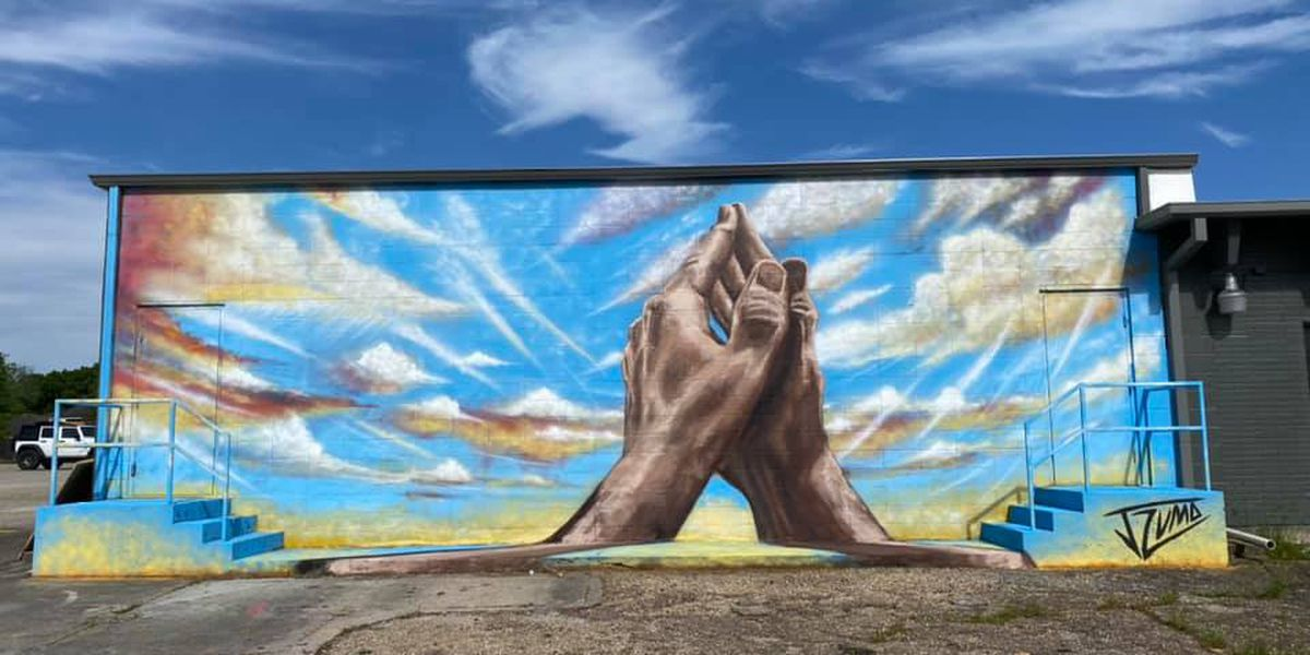 Artist paints mural to spread positive message
