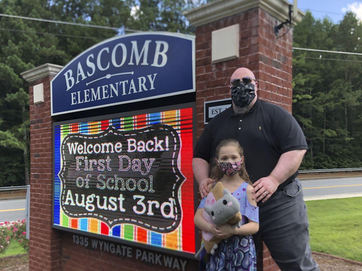 Parents struggle as schools reopen amid coronavirus surge