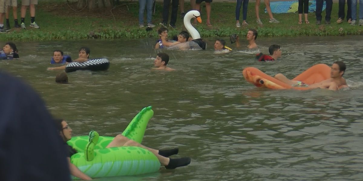 Seniors at East Ascension hold annual pond jump on last day of class