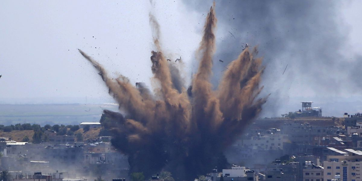 Israel begins firing artillery and tank shells into Gaza