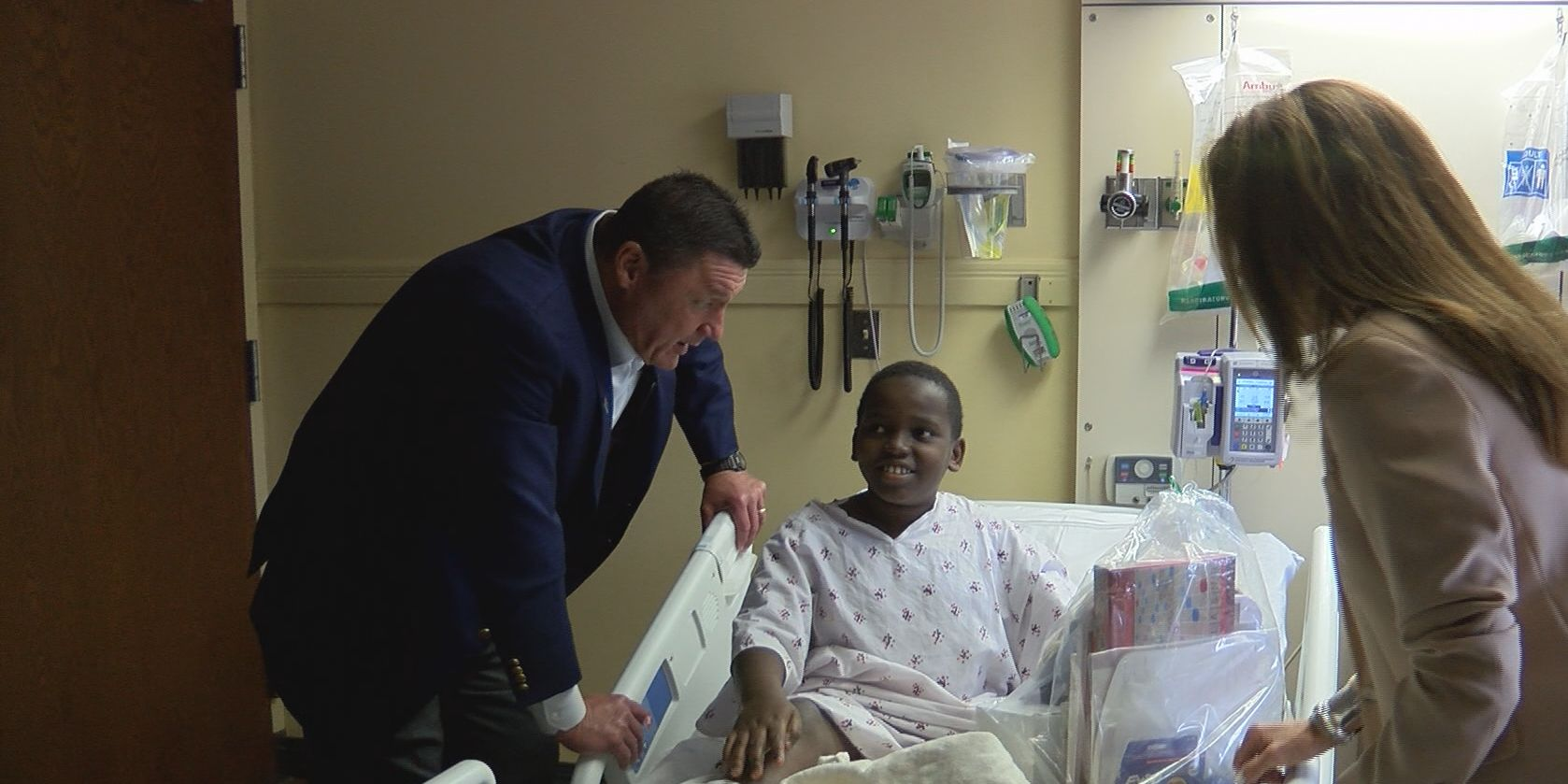 Coach O, wife surprise patients at OLOL Children's Hospital