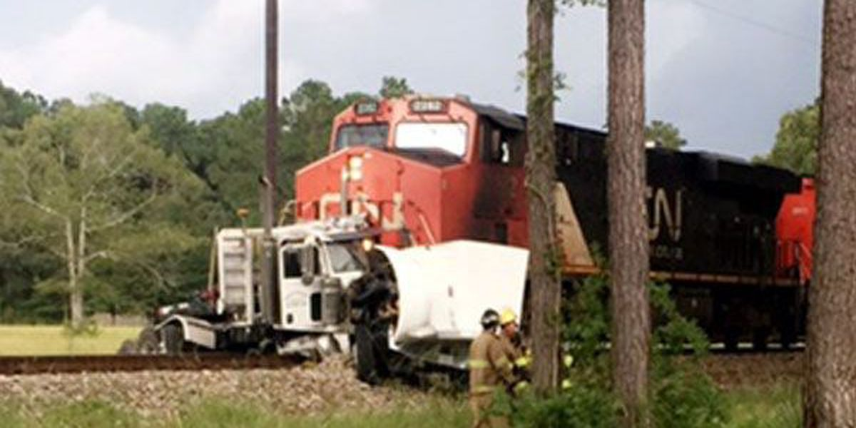 Driver of truck issued citation for crashing into train