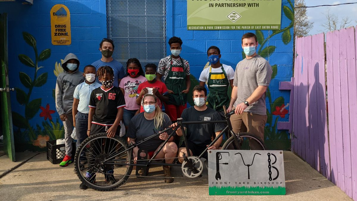 LSU engineering students work with local youth to build hydraulic bike