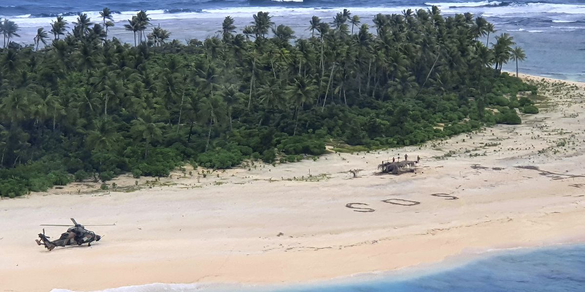 3 men rescued from Pacific island after writing 'SOS' in sand