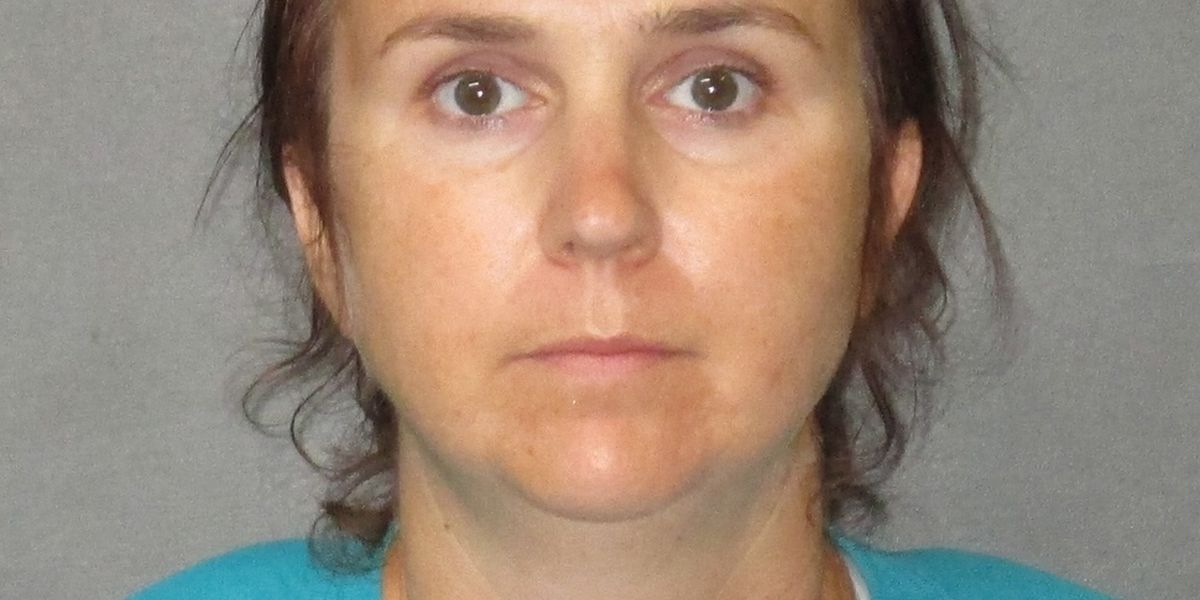 Woman arrested after allegedly brandishing gun at people driving through flooded neighborhood